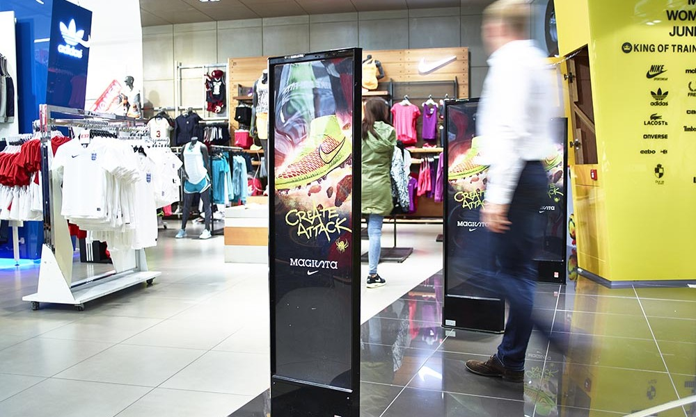 Shot of the entrance of a JD Sports with Agon Systems pedestal and people counting system